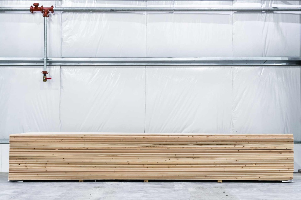 specialty lumber product tongue and groove wood on pallet in mass timber facility