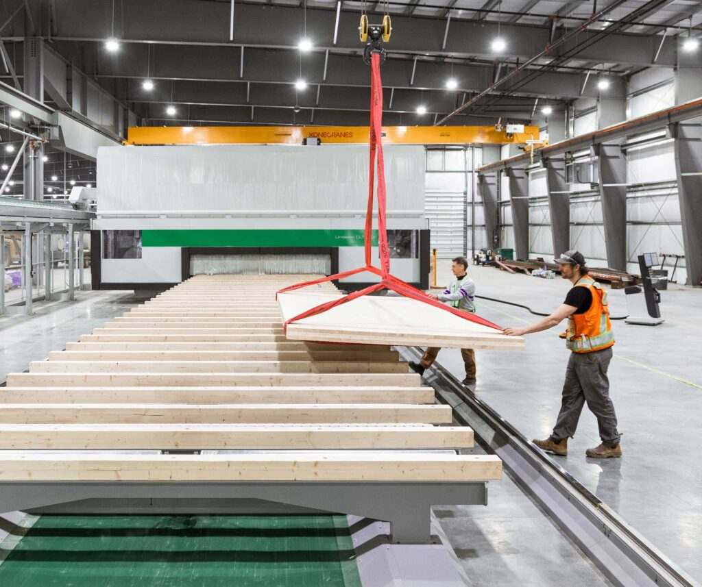 mass timber engineered glulam panel being placed on production line