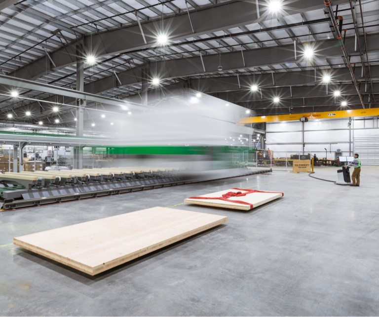 mass timber products facility with two glulam panels on production floor